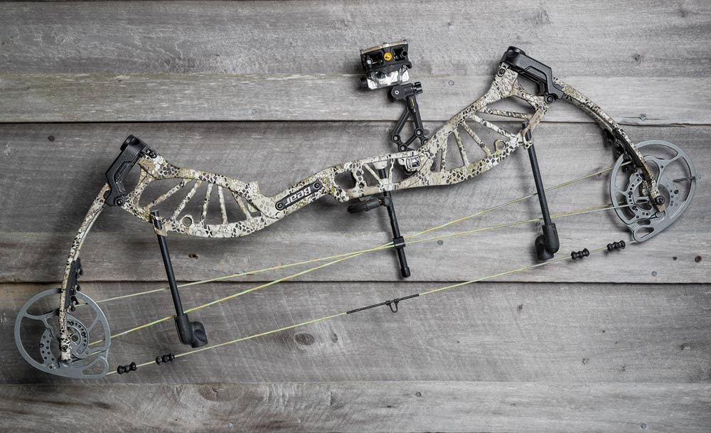 compound bow on wooden table