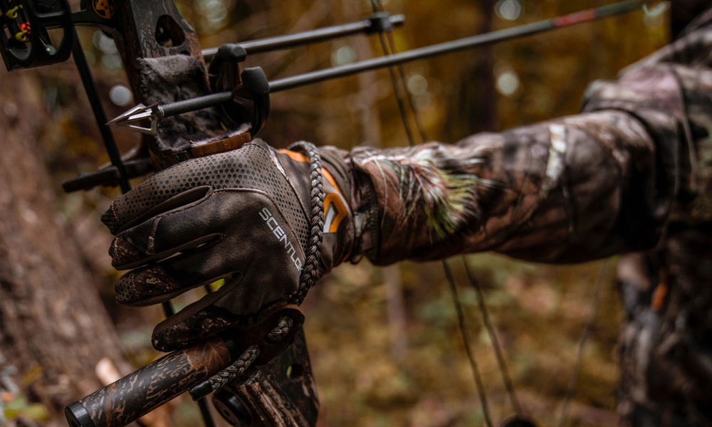 guy holding compound bow